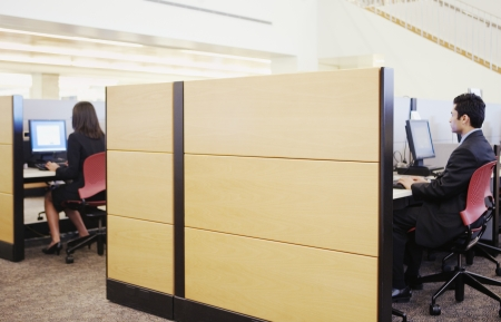 Executives working in cubicles