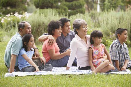 Family sitting on blanket Stock Photo - 16073616