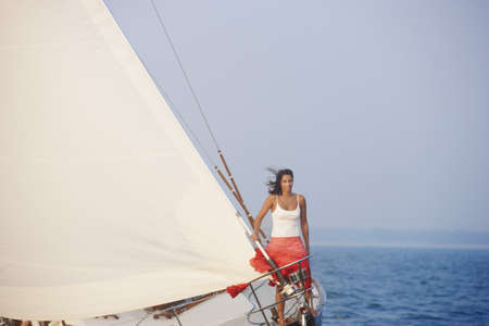 Woman on sailboat Stock Photo - 16073621