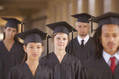 College students in cap and gown Stock Photo - 16073624