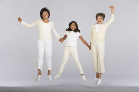 spirited: Female family members jumping together