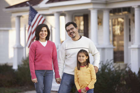 citizenship: Portrait of family in front yard