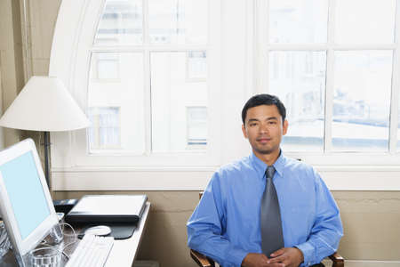 Businessman sitting at desk Stock Photo - 16073664