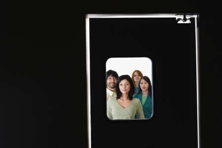 People standing behind door window Stock Photo - 16073676