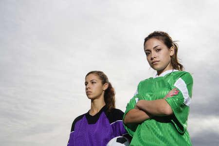 Portrait of two girls in soccer uniforms