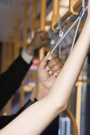 Hands of people holding straps on subway Stock Photo - 16073715