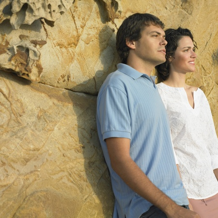 Young couple leaning against rock Stock Photo - 16073724