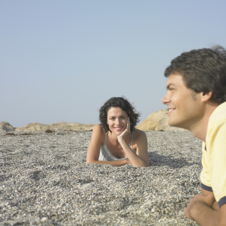 Young couple laying in sun on beach Stock Photo - 16073733