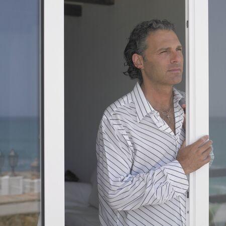 fifty: Man standing in doorway