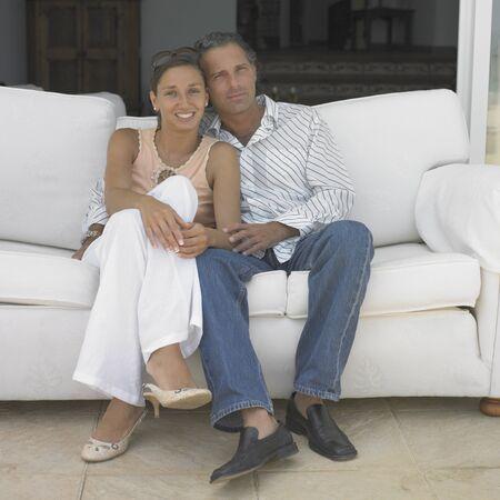 Couple sitting on sofa Stock Photo - 16073745