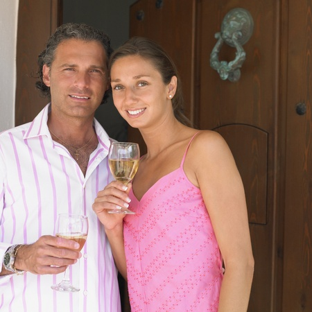 Couple posing with white wine Stock Photo - 16073747