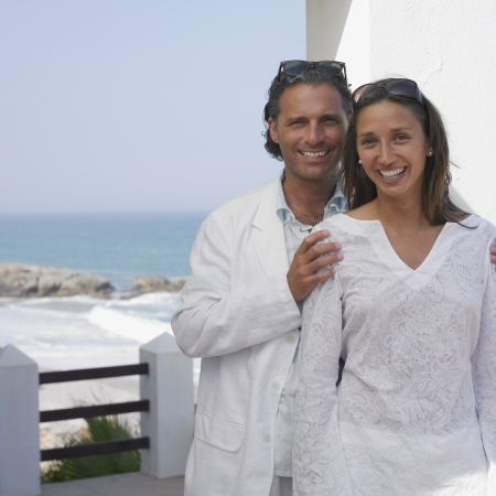 Couple posing on balcony near ocean Stock Photo - 16073757