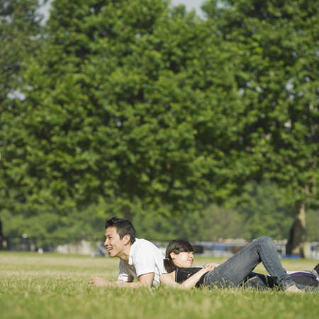 Young couple lounging in grass Stock Photo - 16073766