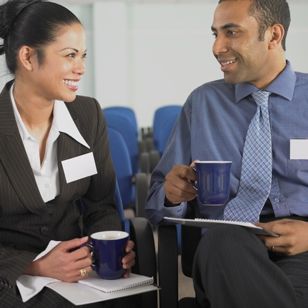 Businesswoman and businessman talking Stock Photo - 16073799