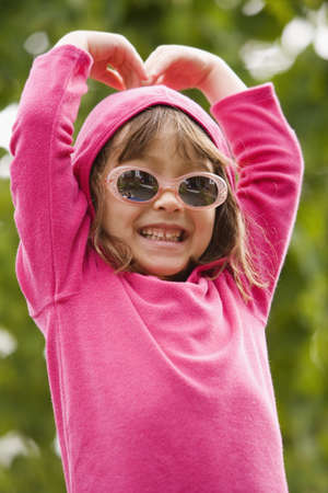 unconcerned: Portrait of girl wearing sunglasses