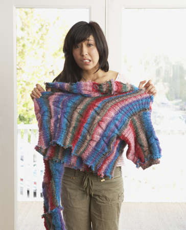 disgruntled: Portrait of woman with knitted sweater disaster