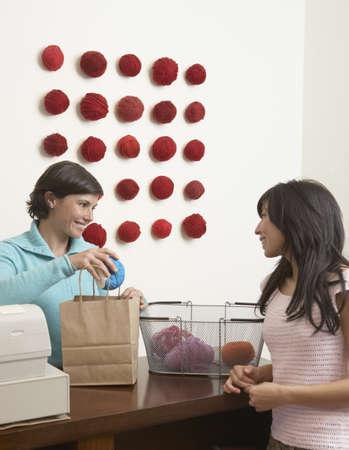packer: Woman buying yarn in yarn store