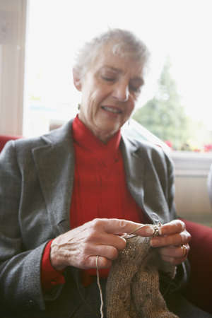 ninetys: Senior woman knitting