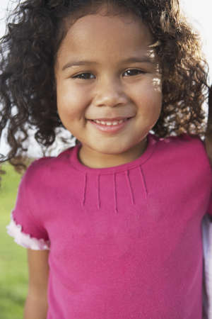 mixed race girl: Portrait of young girl smiling