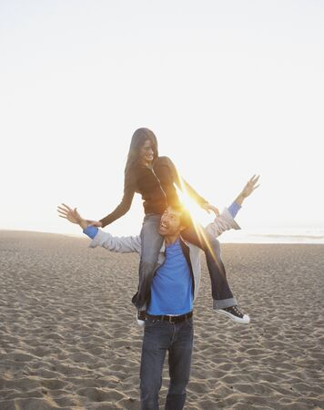 Couple playing on beach Stock Photo - 16073889