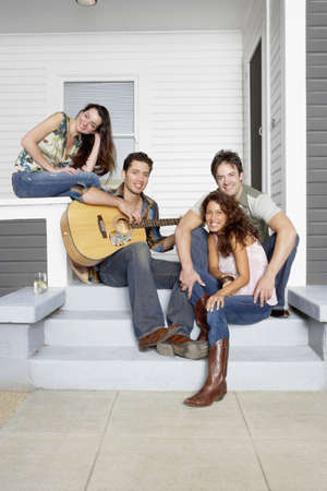 Portrait of young couples on porch with guitar Stock Photo - 16073893