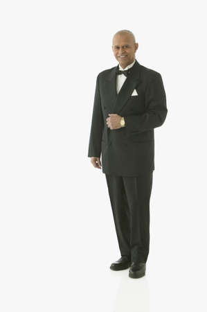 only mid adult men: Full view portrait of man in tuxedo LANG_EVOIMAGES
