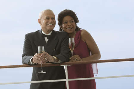dinner cruise: Formal couple drinking wine together