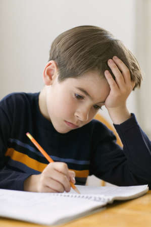 writing western: Young boy doing homework LANG_EVOIMAGES