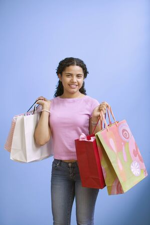 Portrait of teenage girl holding gift bags Stock Photo - 16073950