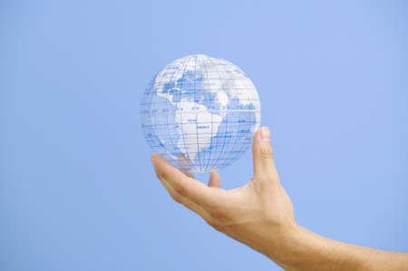 holding close: Close up of hand holding globe