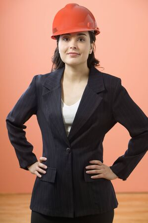 foresight: Portrait of businesswoman posing with hard hat