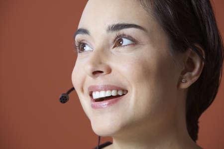 earpiece: Woman with earpiece smiling