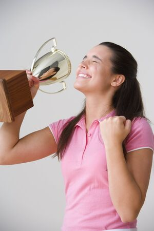 Portrait of excited teenage girl with trophy Stock Photo - 16074005