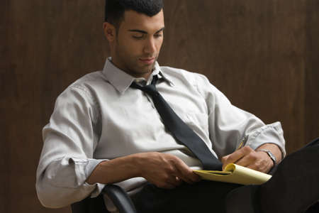 casualness: Businessman sitting and writing notes