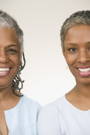 ninety's: Portrait of mother and daughter standing side by side