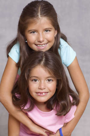 attentiveness: Portrait of two girls smiling