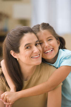 Portrait of daughter hugging mother Stock Photo - 16074047