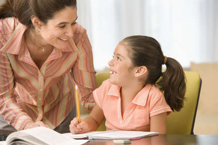 solicitous: Mother helping daughter with homework