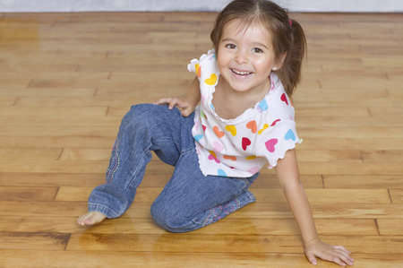 Portrait of young girl kneeling on floor Stock Photo - 16074053
