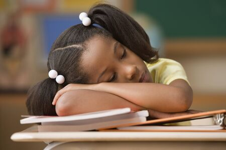 siesta: Student sleeping at her desk