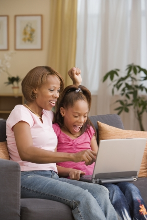 davenport: Mother and daughter using a laptop together