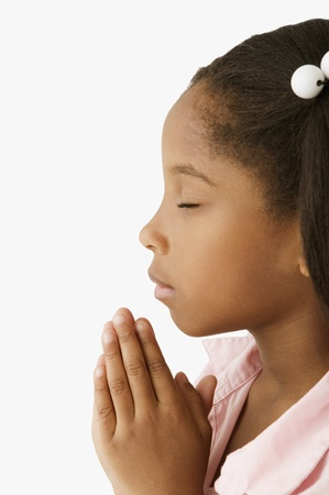 african american silhouette: Young girl praying