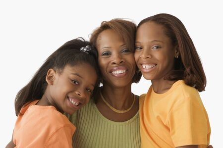 solicitous: Mother and daughters smiling for the camera