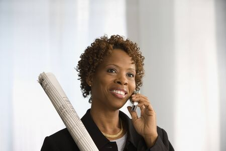acknowledging: Businesswoman talking on a cell phone