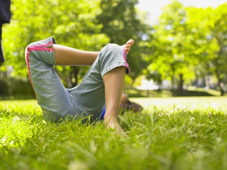 lower section: Lower section of girl laying in grass