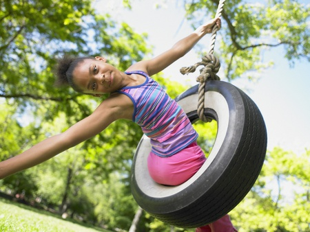 only 1 girl: Portrait of girl on tire swing