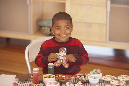 Young boy making gingerbread men Stock Photo - 16074191