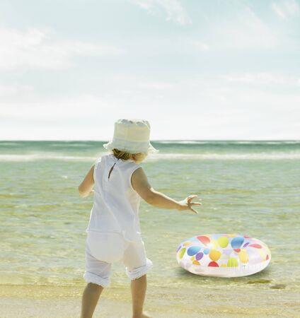 endangering: Little girl watching her inner tube float away LANG_EVOIMAGES