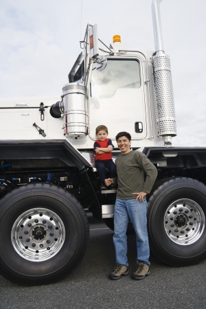 Father standing with his son by their truck