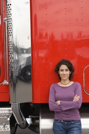 truck driver: Young woman standing by her truck